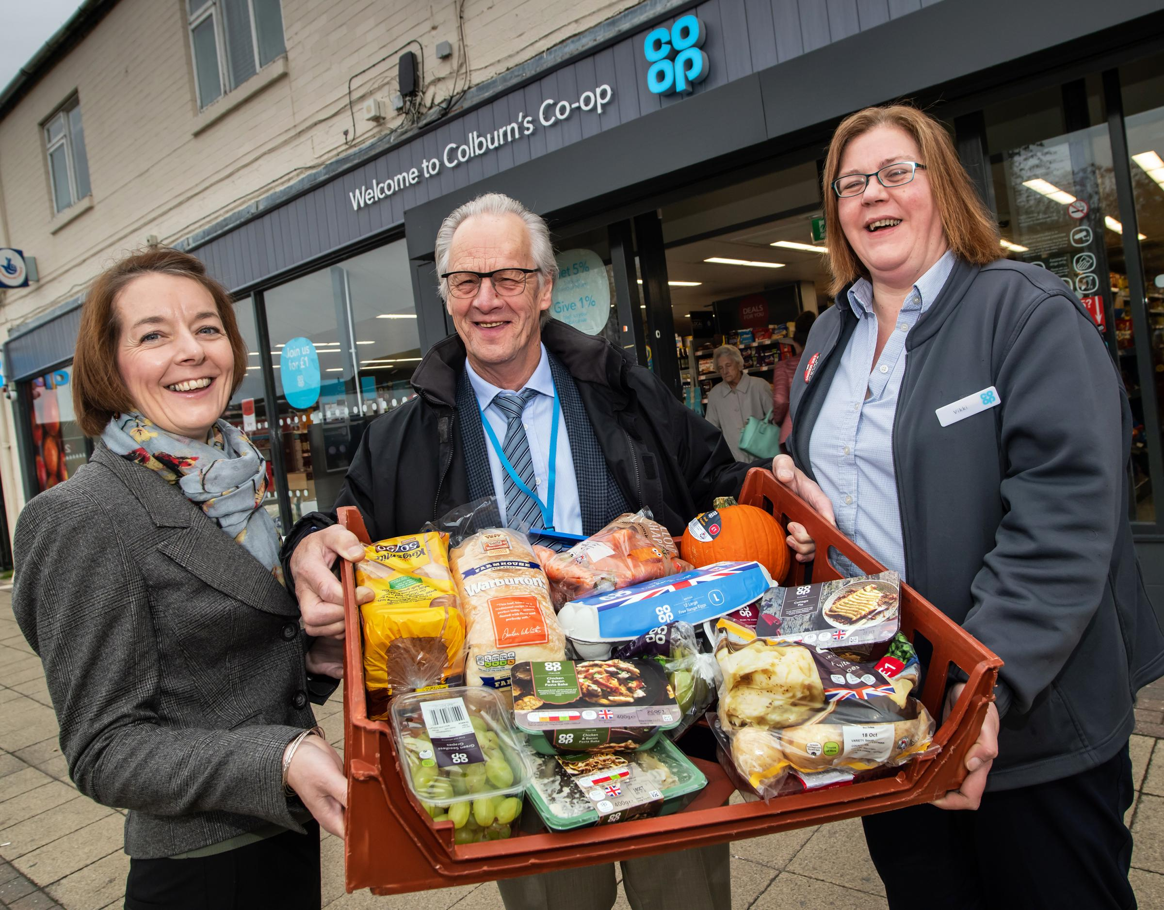 FOOD: Cllr Ian Threlfall with Anne Griffiths, warden at George Nickling House and Vikki Glendinning from the Co-op