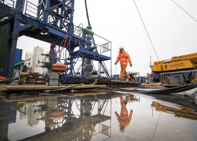 File photo dated 05/10/18 of a worker at the Cuadrilla fracking site in Preston New Road, Little Plumpton, Lancashire. An environmental campaigner is to go to the High Court in a bid to stop the energy firm from fracking the UK's first horizontal shal