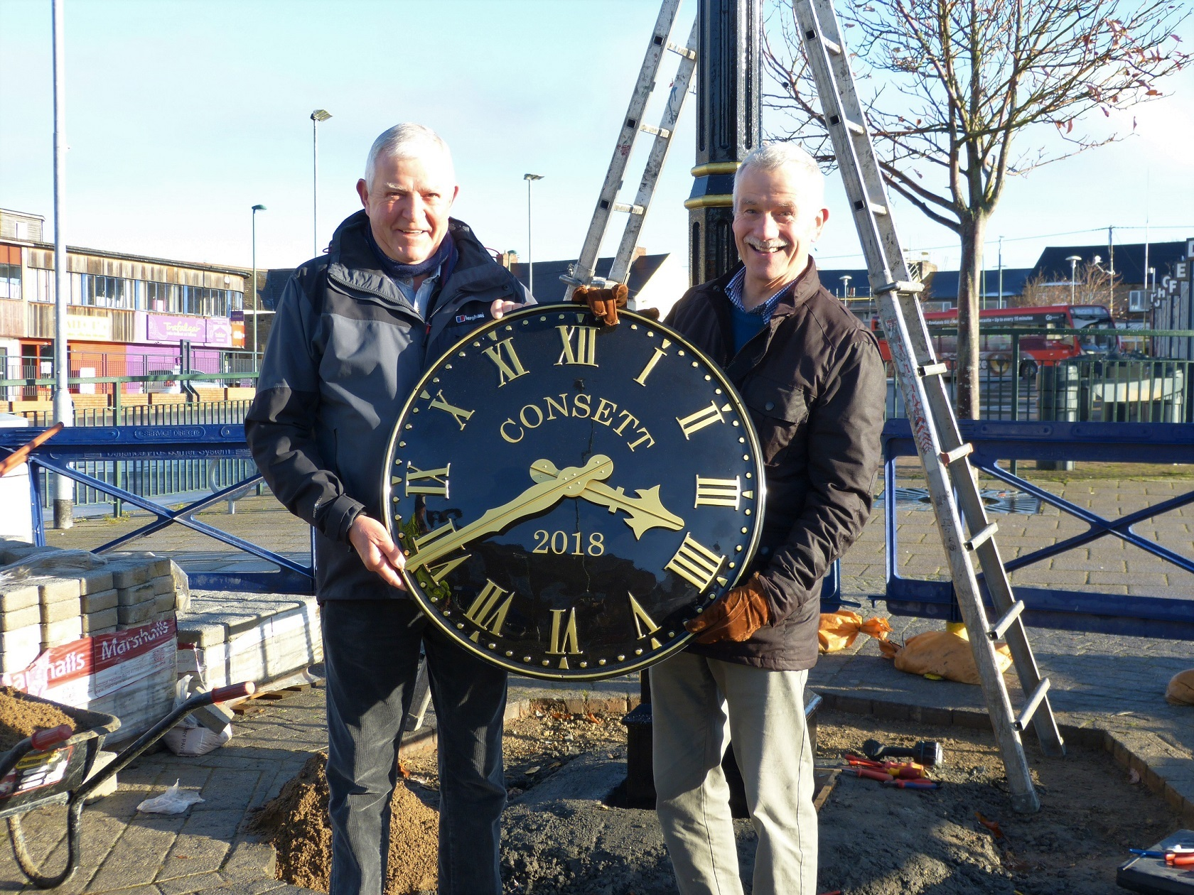TIME PIECE: Durham County Councillors Owen Temple and Alex Watson with the new community clock in Consett town centre