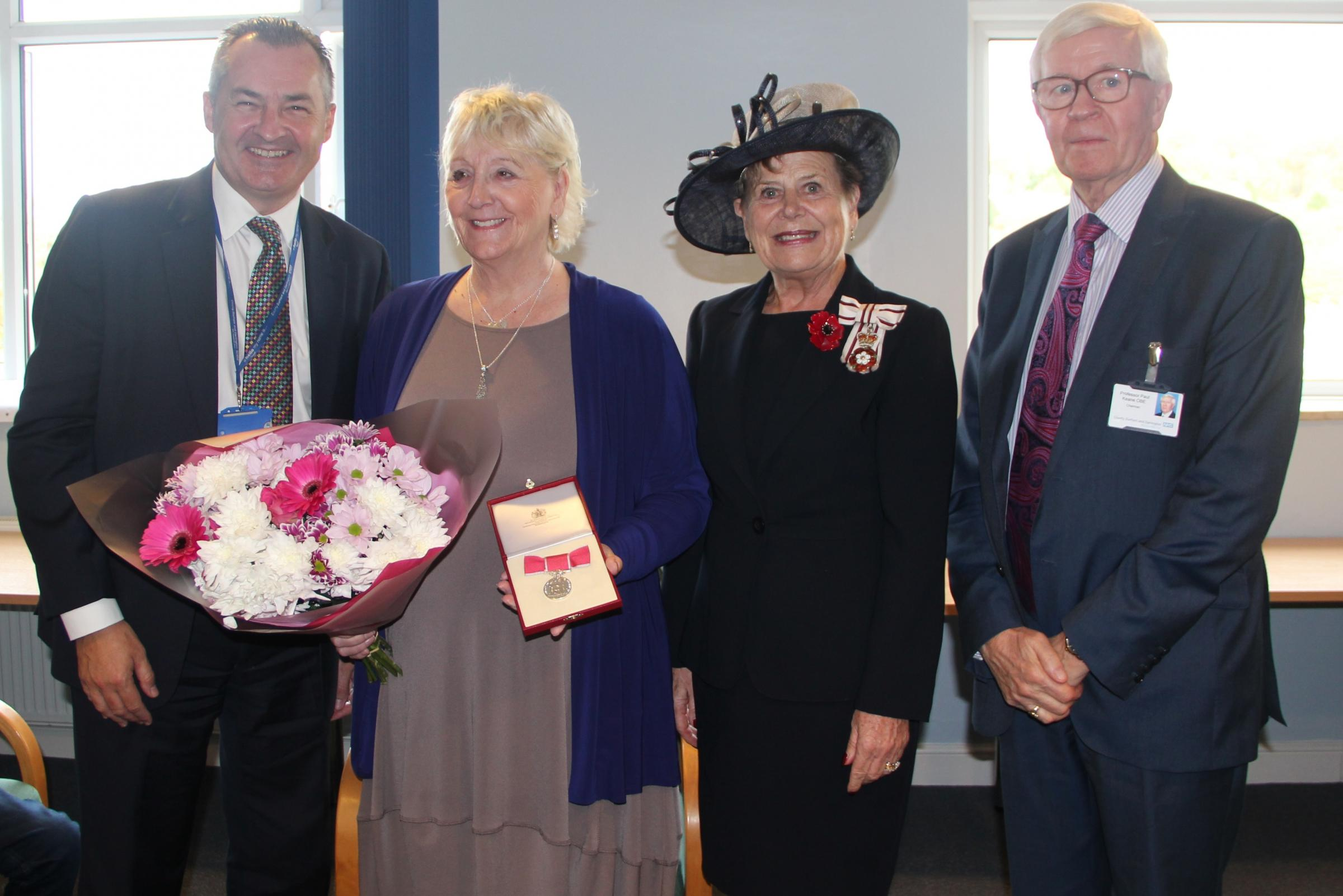 MEDICAL HERO: Mary Richardson, pictured with Mrs Sue Snowdon, Her Majesty's Lord-Lieutenant of County Durham, Noel Scanlon, director of nursing & Professor Paul Keane OBE, Chairman, County Durham & Darlington NHS Foundation Trust