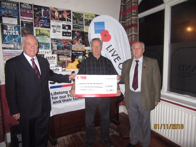 CHEQUE: A charity night boosted the two charities