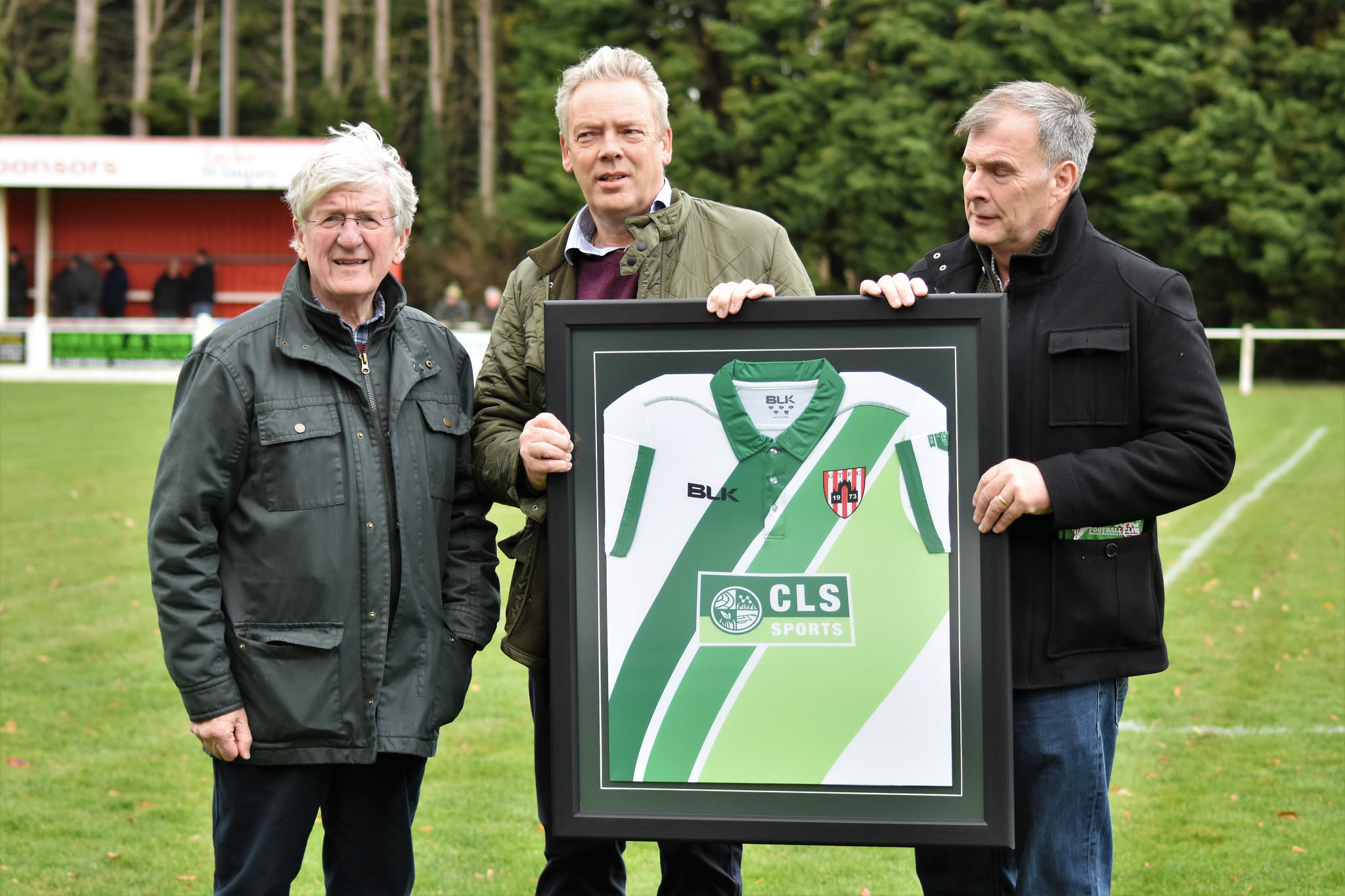 Guisborough Town Chairman Don Cowan (left) with members of Cleveland Land Services, one of the club's main sponsors.  Mr Cowan presented a framed copy of the club's smart new green and white away strip