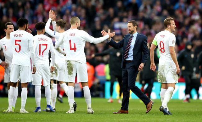 WINNING FEELING: Gareth Southgate celebrates with his England players in the wake of their 2-1 win over Croatia (Picture: Nick Potts/ PA Wire)