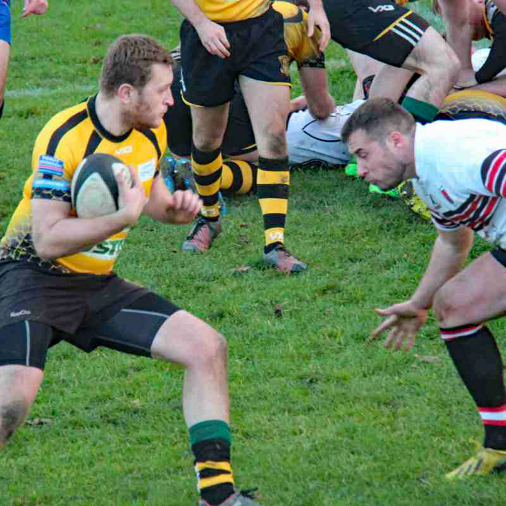 Joe Whyman, Guisborough's try scorer and conversion kicker emerges from the scrum to be challenged immediately