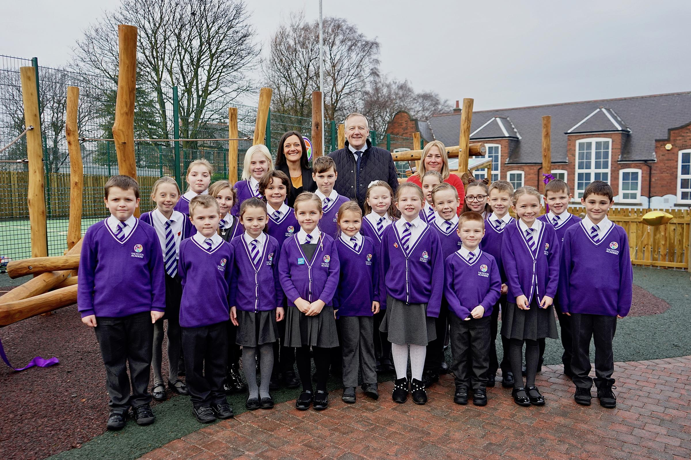 Sacriston Academy children with, from left, Annalei Inkster, Kevan Jones and Lesley Powell
