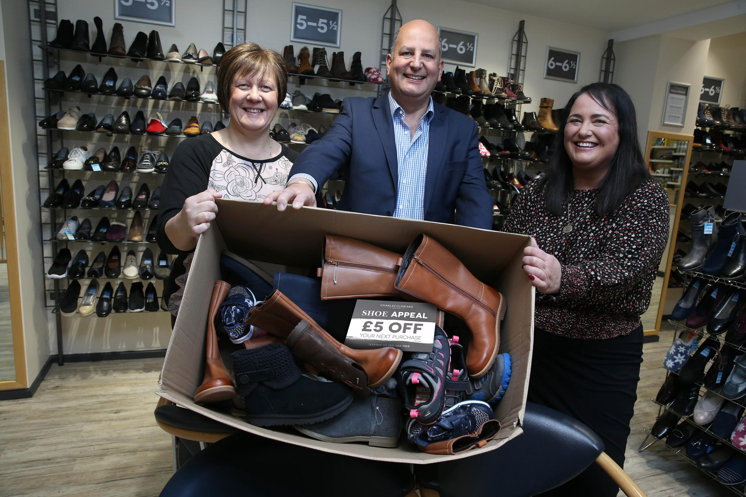 Teesside Philanthropic Foundation's Diane Williamson, left, with Charles Clinkard and store manager Gina Ditchburn, right