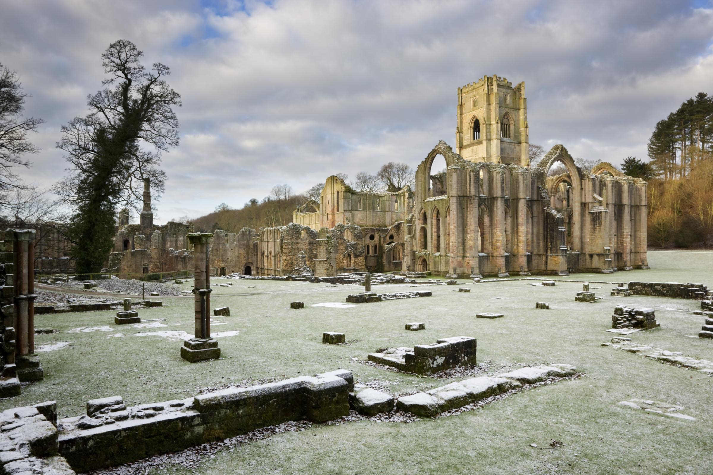A winter view towards the East end of the Abbey church showing the great East window arch at Fountains Abbey, North Yorkshire