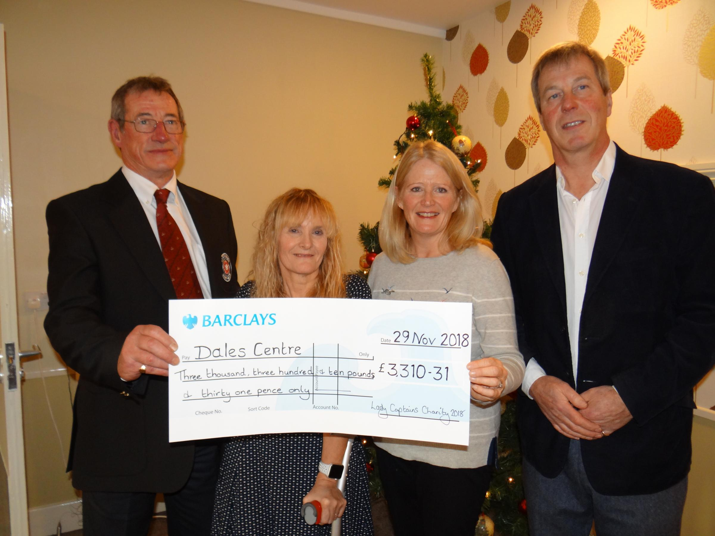 DALES CENTRE: Money raised by Catterick lady golfers is handed over