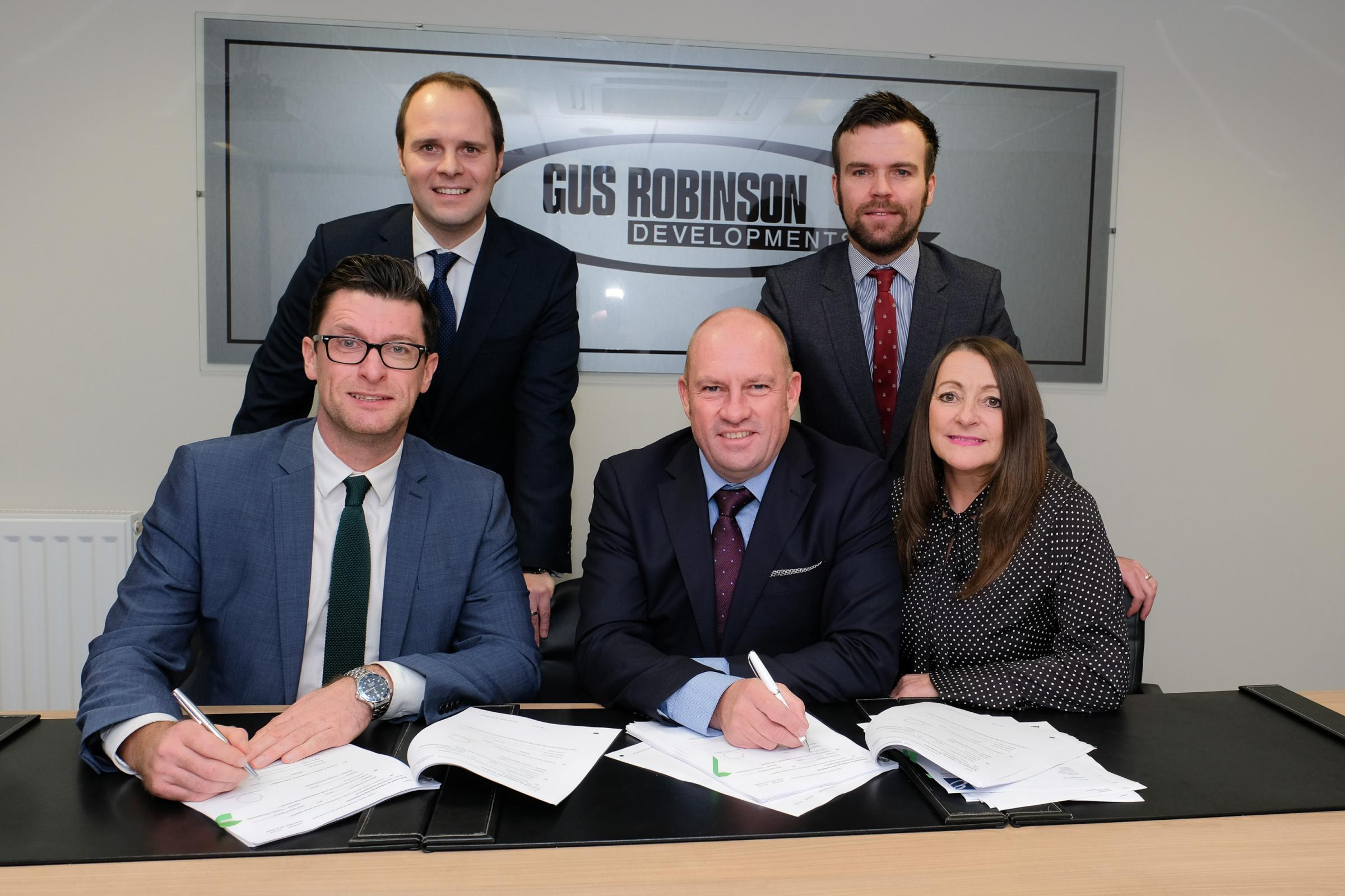 NEW SIGNING: David Nixon and Carl Swansbury from RG Corporate Finance. Front Row: Craig Taylor, of Thirteen, Stephen Bell, of Gus Robinson Developments and Jeanette Henderson, Gus Robinson Developments