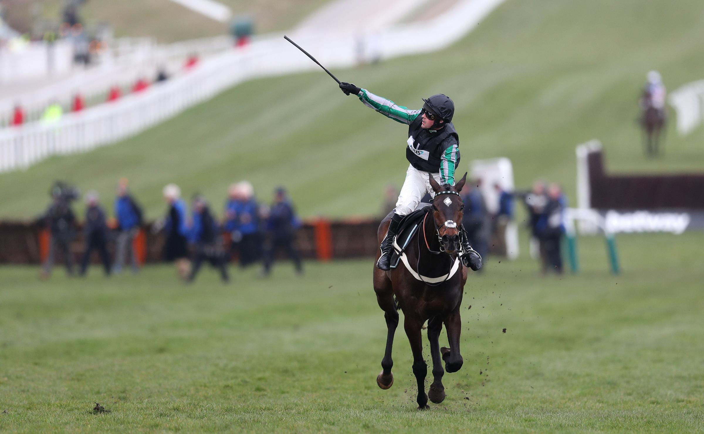 Altior and jockey Nico de Boinville after winning the Betway Queen Mother Champion Chase during Ladies Day of the 2018 Cheltenham Festival at Cheltenham Racecourse. PRESS ASSOCIATION Photo. Picture date: Wednesday March 14, 2018. See PA story RACING Chelt