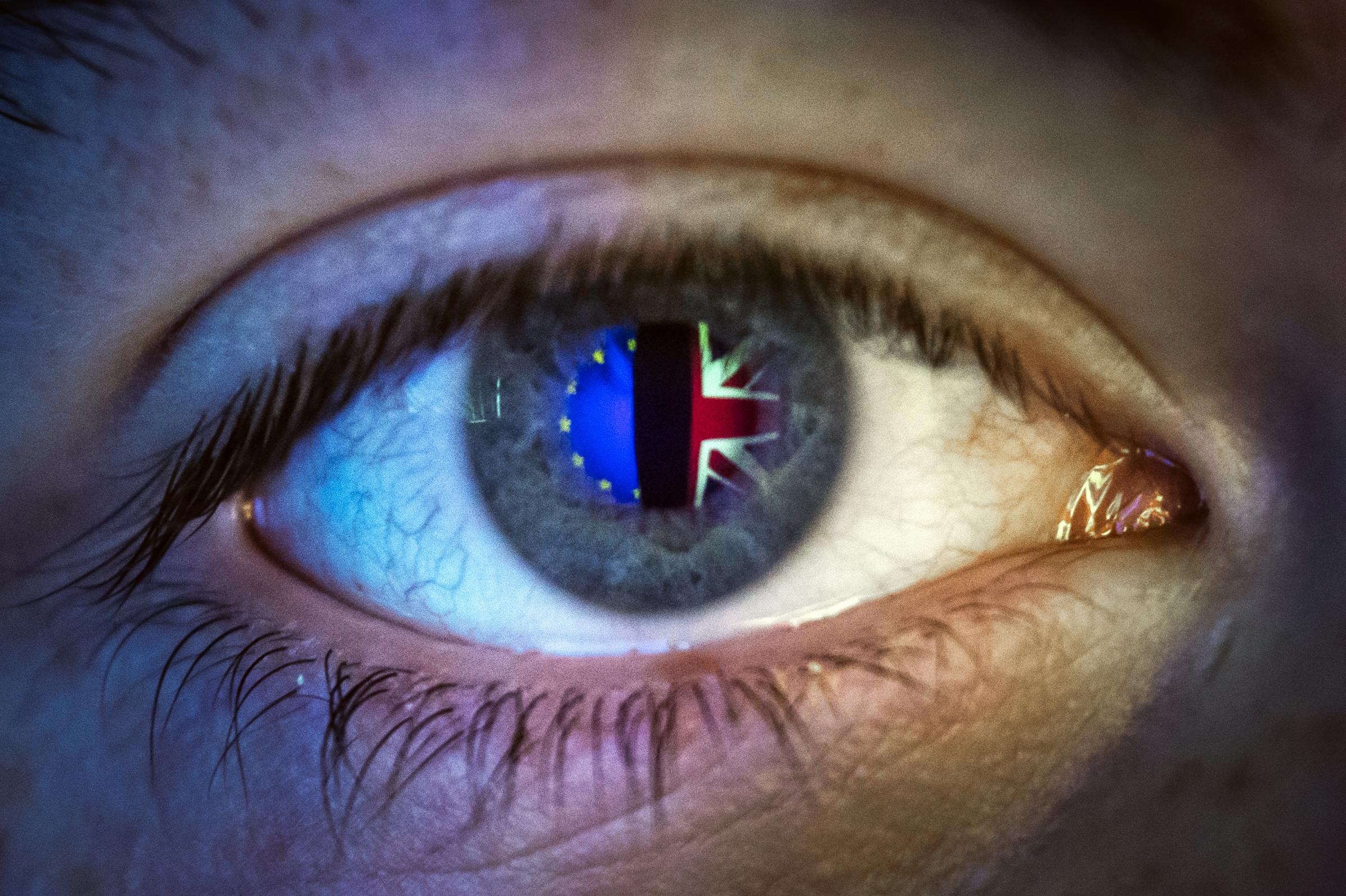 Reflections of a European flag (left) and Union flag, seen in a person's eye Picture: PA