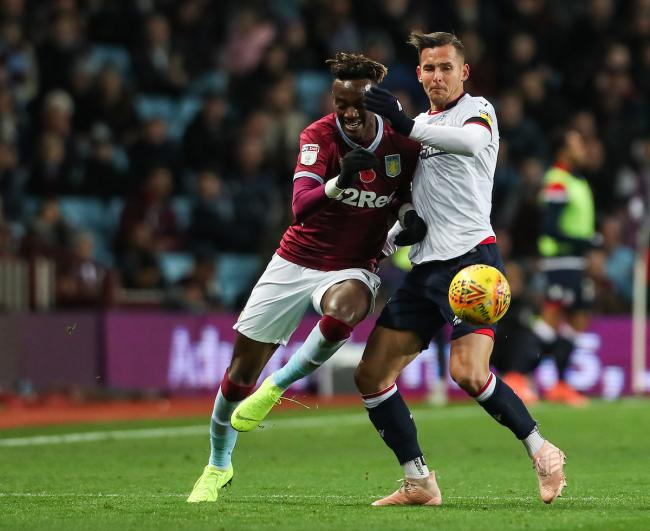 Bolton Wanderers' Pawel Olkowski competing with Aston Villa's Tammy Abraham. Picture: CameraSport