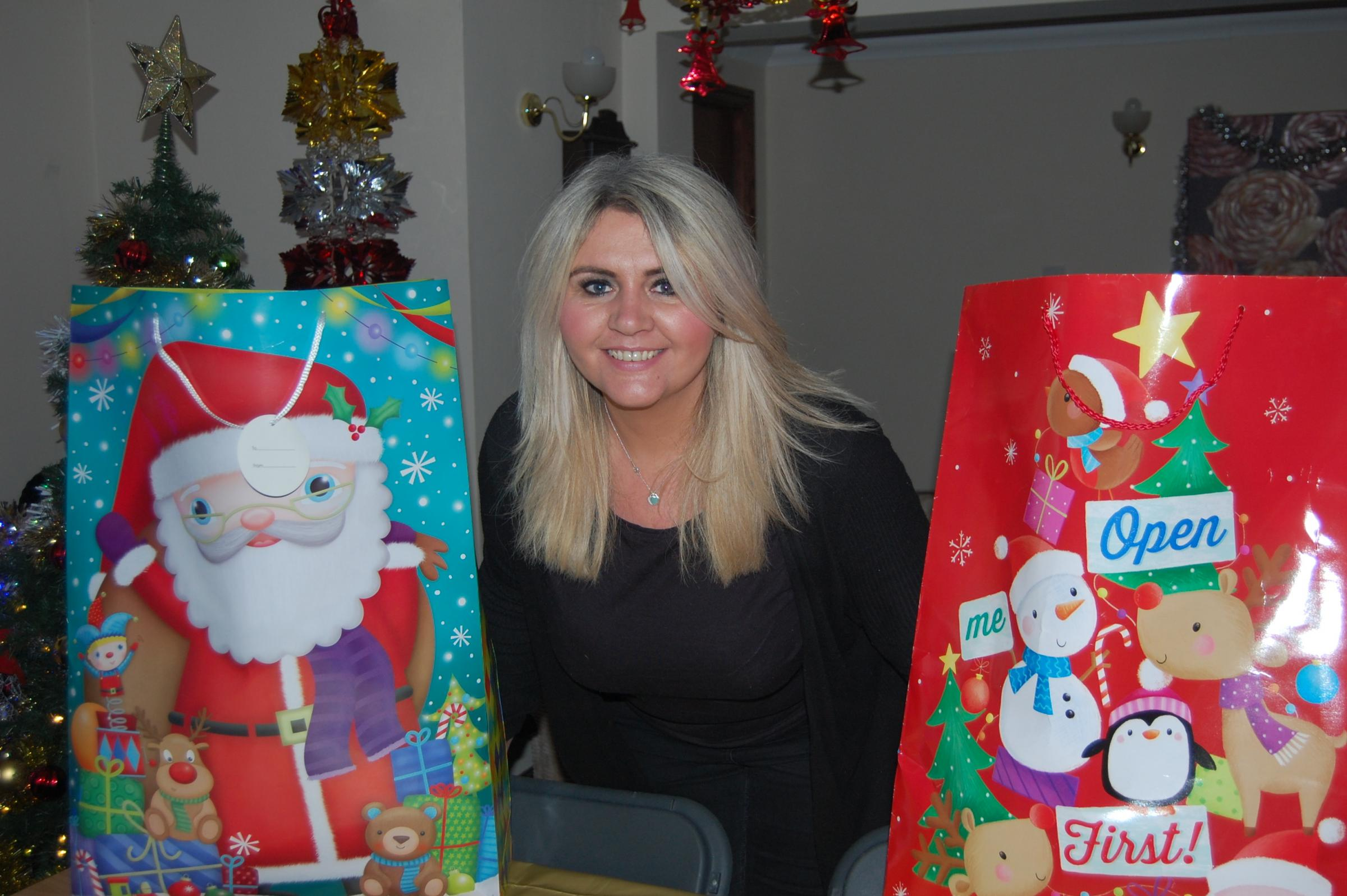 COMMUNITY KINDNESS: Dawn Winn with some of the presents for veterans