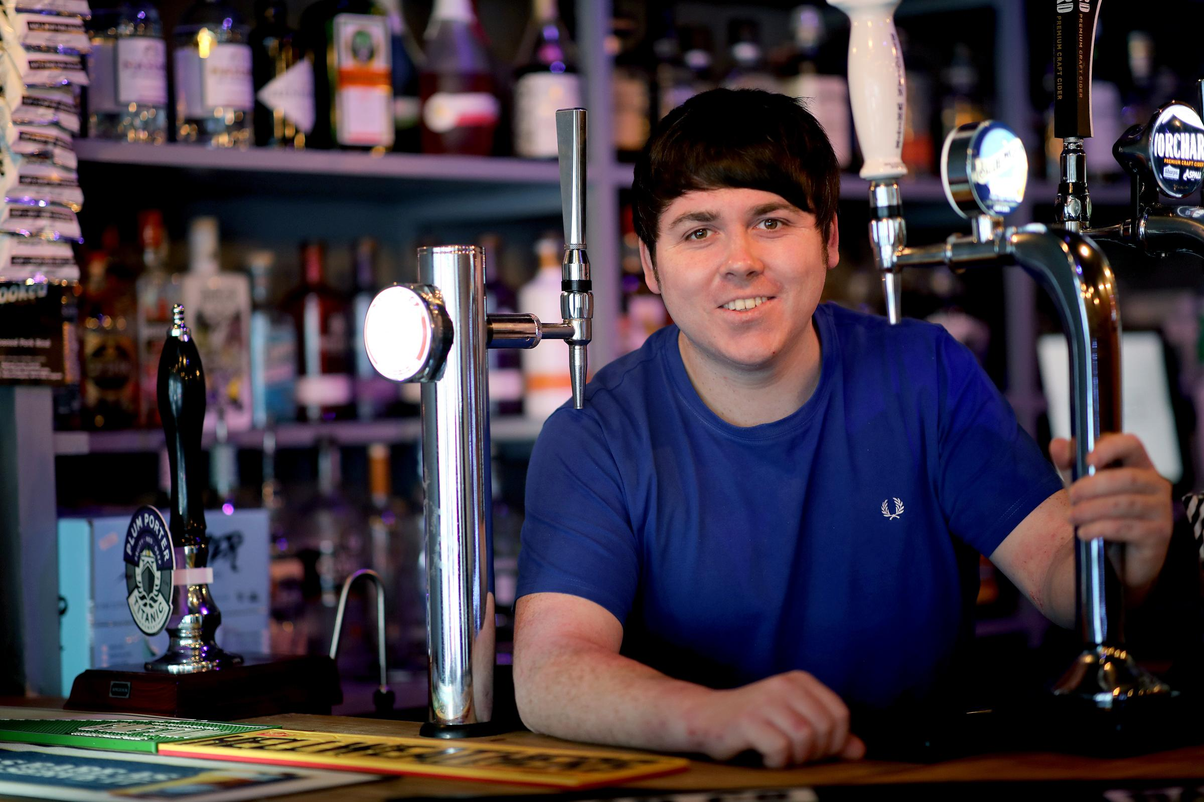 NEW BARS: Lee Shore behind the bar of The Halt in Redcar