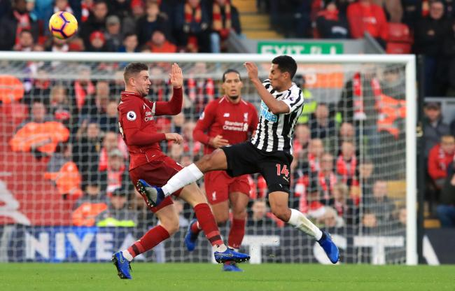 Liverpool's Jordan Henderson (left) and Newcastle United's Isaac Hayden battle for the ball during the Premier League match at Anfield, Liverpool. PRESS ASSOCIATION Photo. Picture date: Wednesday December 26, 2018. See PA story SOCCER Liverpool. P