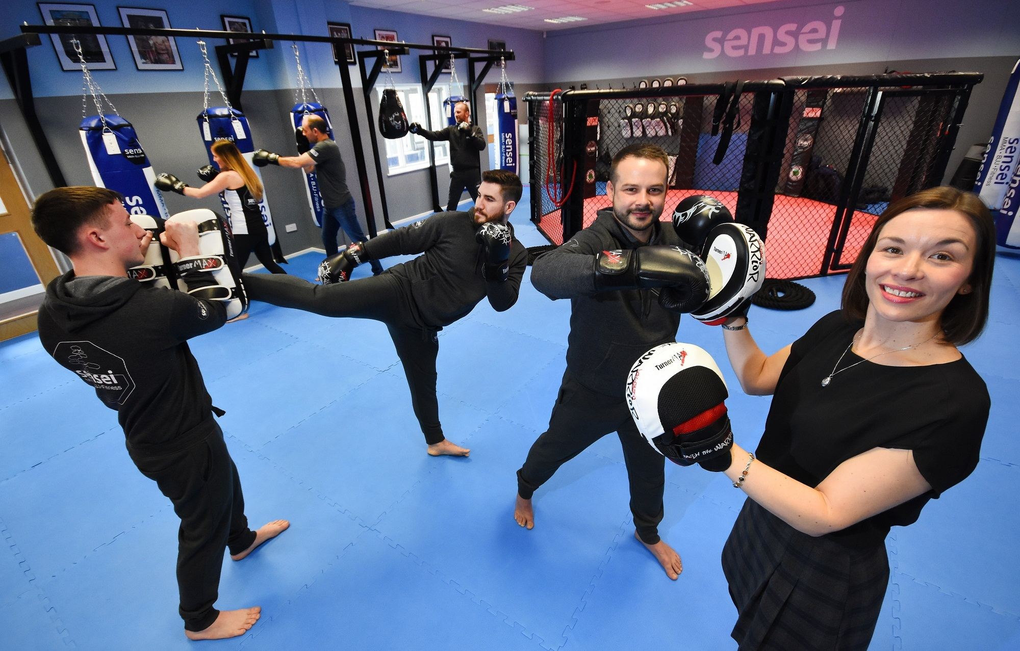 MARTIAL ARTS: Owner Rick Boyle, centre, with TEDCO business advisor, Judith Wheatley, working out in the new martial arts centre