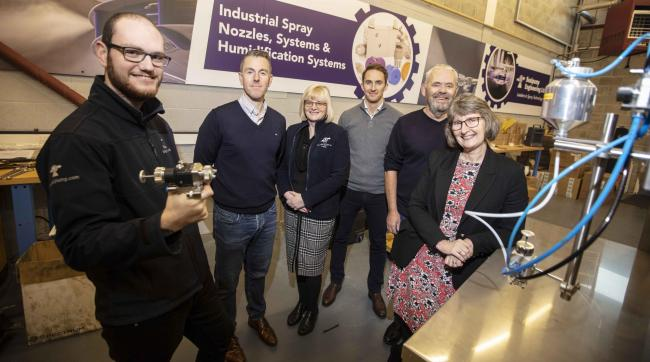 BIG PLANS: Ainsley Claxton, who originally joined  the Sealpump Engineering team as its first apprentice with Stuart Brown, Julie Thorpe, Stephen Larkin, John Champley and  UK Steel Enterprise's Sue Kirk
