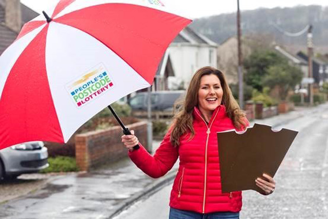 CONGRATULATING WINNERS: Judith McCourt is the face of the People's Postcode Lottery