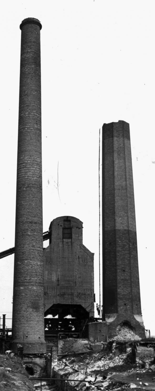 TO THE TOP: You can see the demolition ladder going up the Bearpark chimney which Robin climbed – although demolition has already begun in this photo, as the chimney has lost its death-defying top