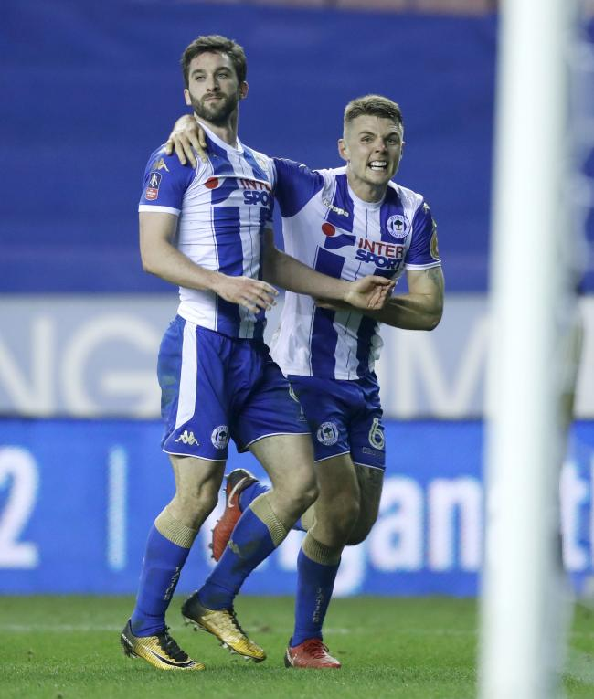 Wigan Athletic's Will Grigg (left) celebrates scoring his side's first goal of the game during the Emirates FA Cup, Fifth Round match at the DW Stadium, Wigan. Picture: PA
