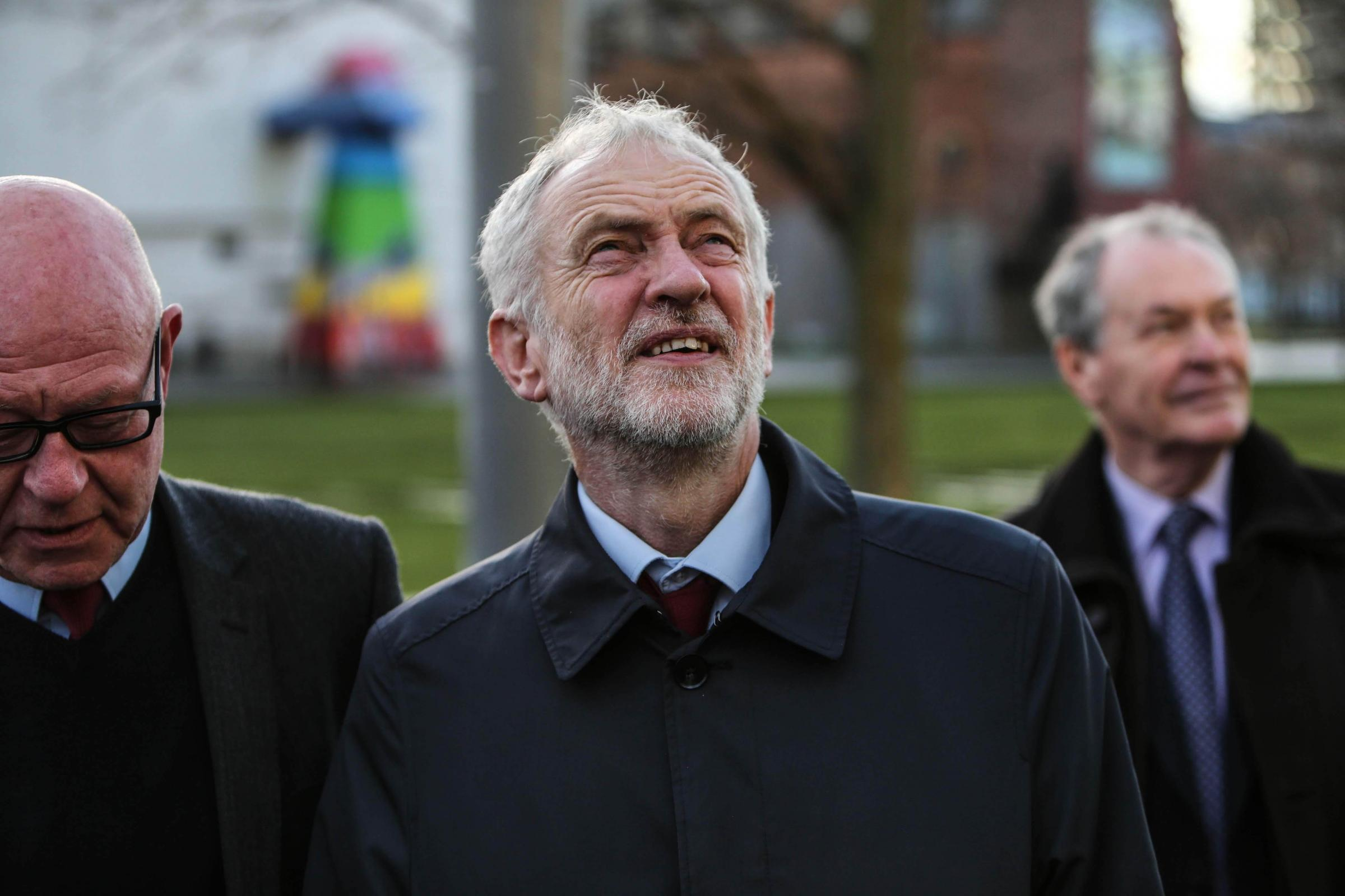 LOOKING UP: Jeremy Corbyn admires the building work in Middlesbrough with, left, the party's local mayoral candidate, Mick Thompson, and outgoing Boro mayor, David Budd. Picture: TOM BANKS