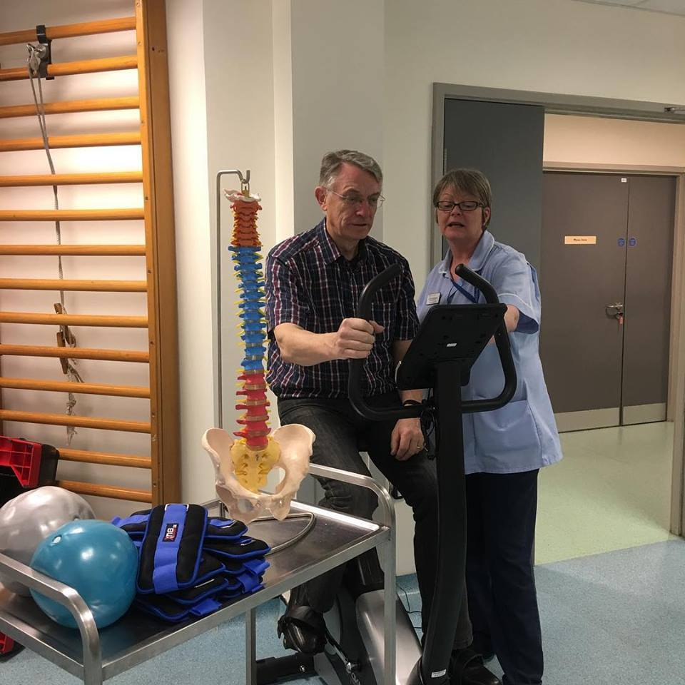 NEW EQUIPMENT: Lynne Matthews, a member of the physiotherapy team, shows committee member Allan Jones the new exercise cycle