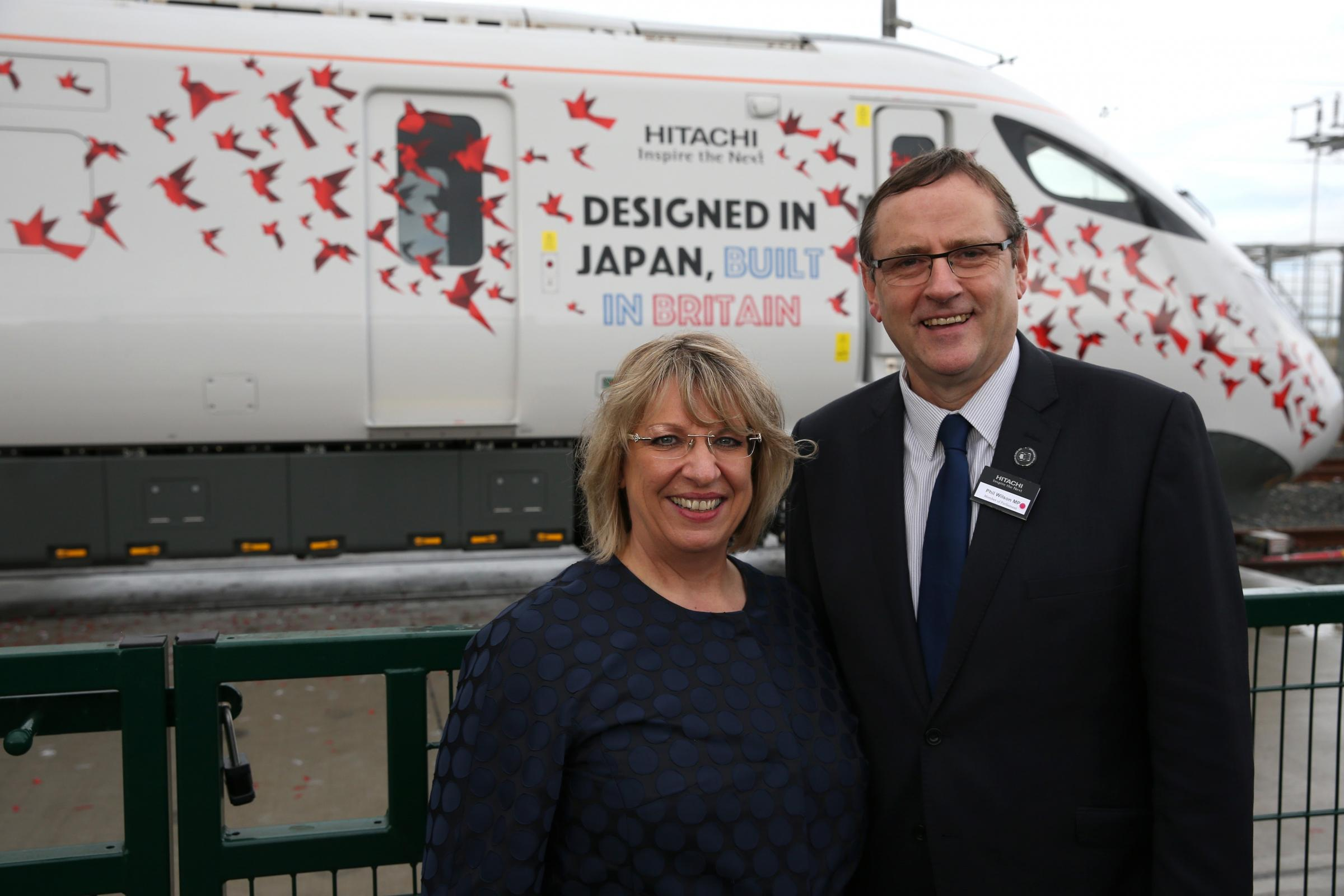 HAPPIER TIMES: Karen Boswell, now group chief administration officer at Hitachi and Sedgefield MP Phil Wilson at the firm's Intercity Express Train Launch in Newton Aycliffe in 2016 Picture: CHRIS BOOTH