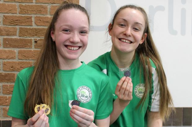 STAR SWIMMERS: Harriet Rogers with her five medals and Molly Mooney
