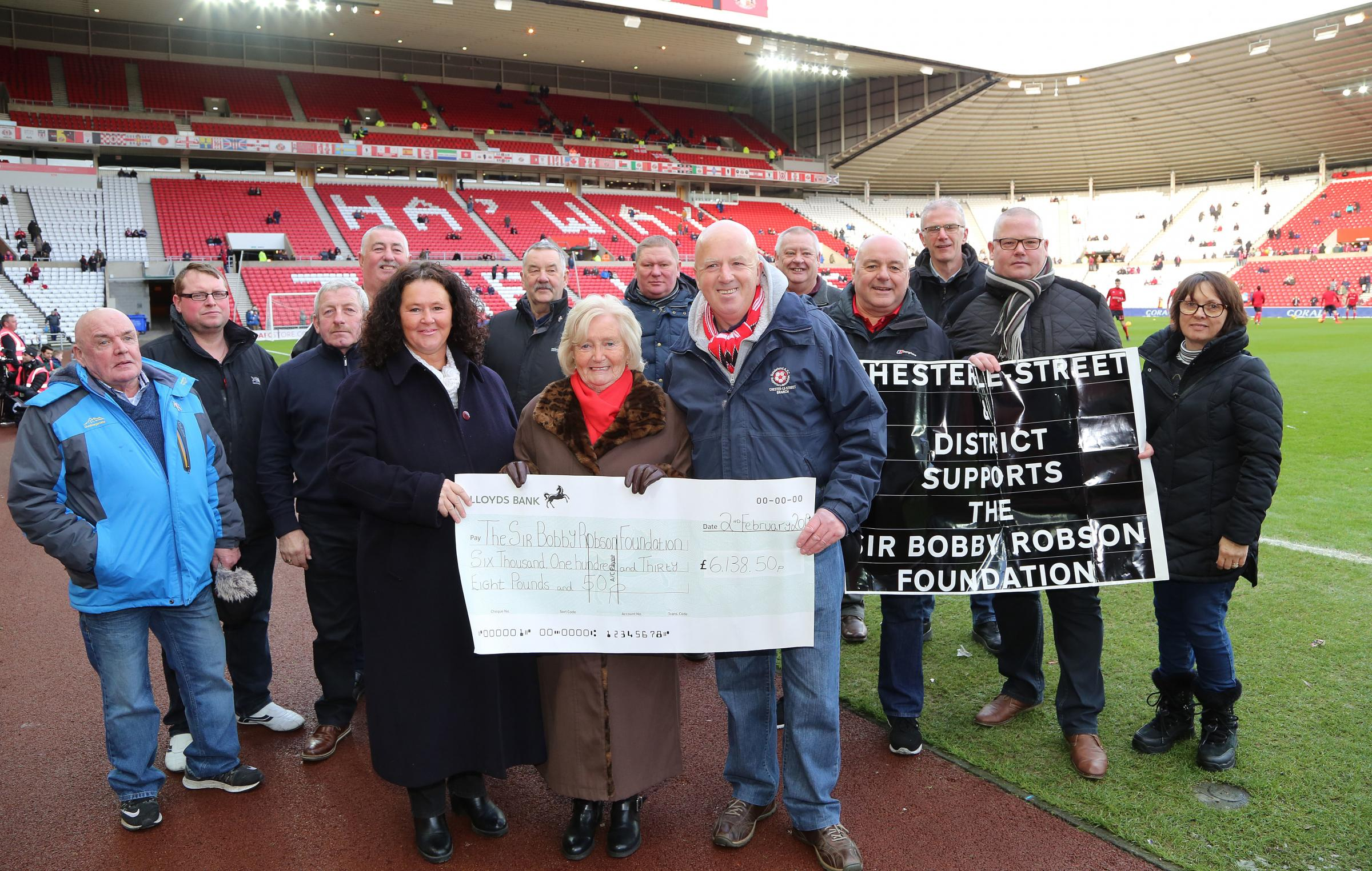 MONEY RAISED: Lady Elsie was very proud to receive the cheque on Sunday, just before Sunderland's win against Wimbledon. She was pictured with representatives of Sid's Tours pitch side at the Stadium of Light