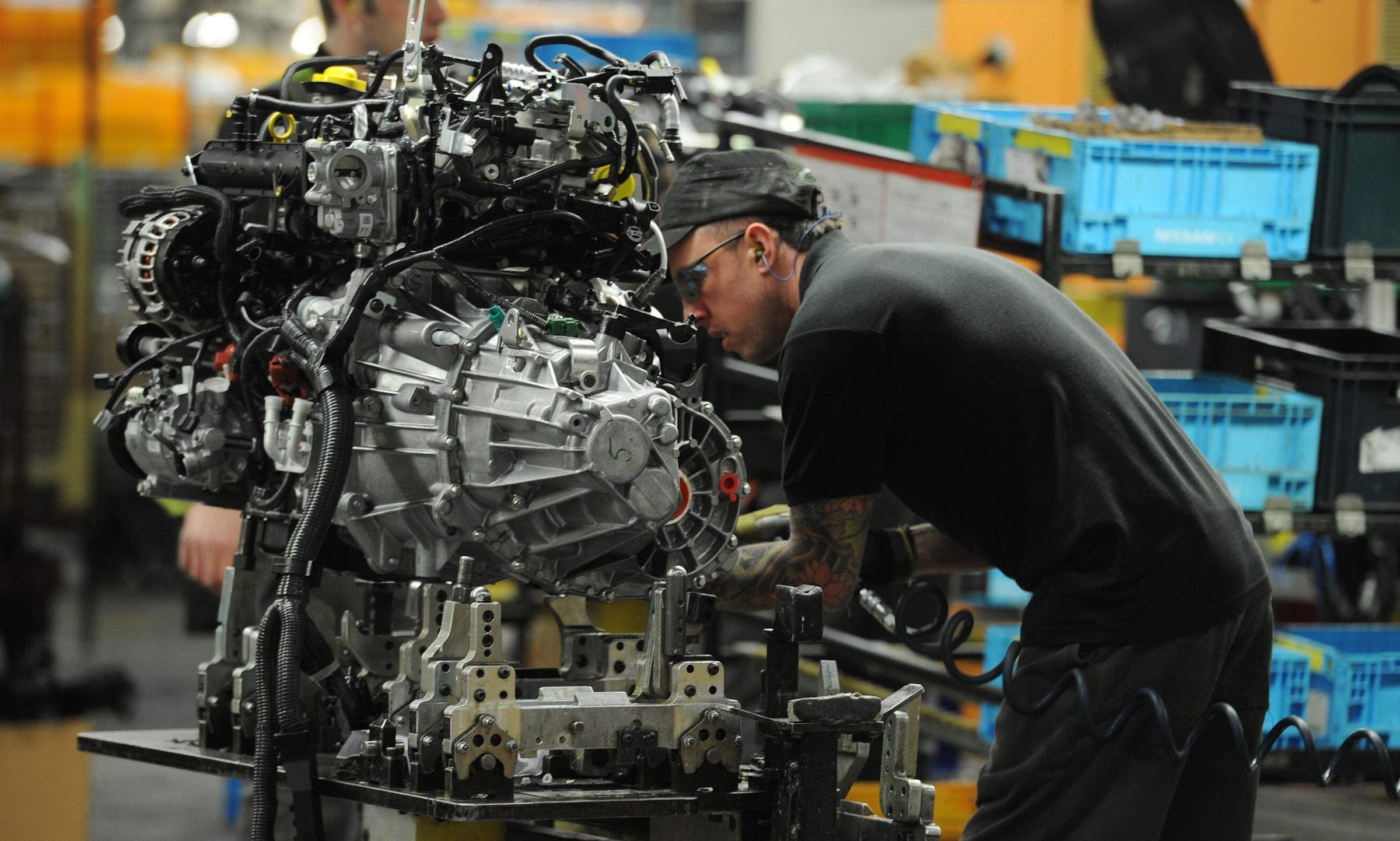 File photo dated 22/01/14 of a Nissan employee working on the second generation Qashqai, at the Nissan plant in Sunderland. George Osborne will make a pitch to ordinary working people today when he delivers his penultimate Budget before the general electi