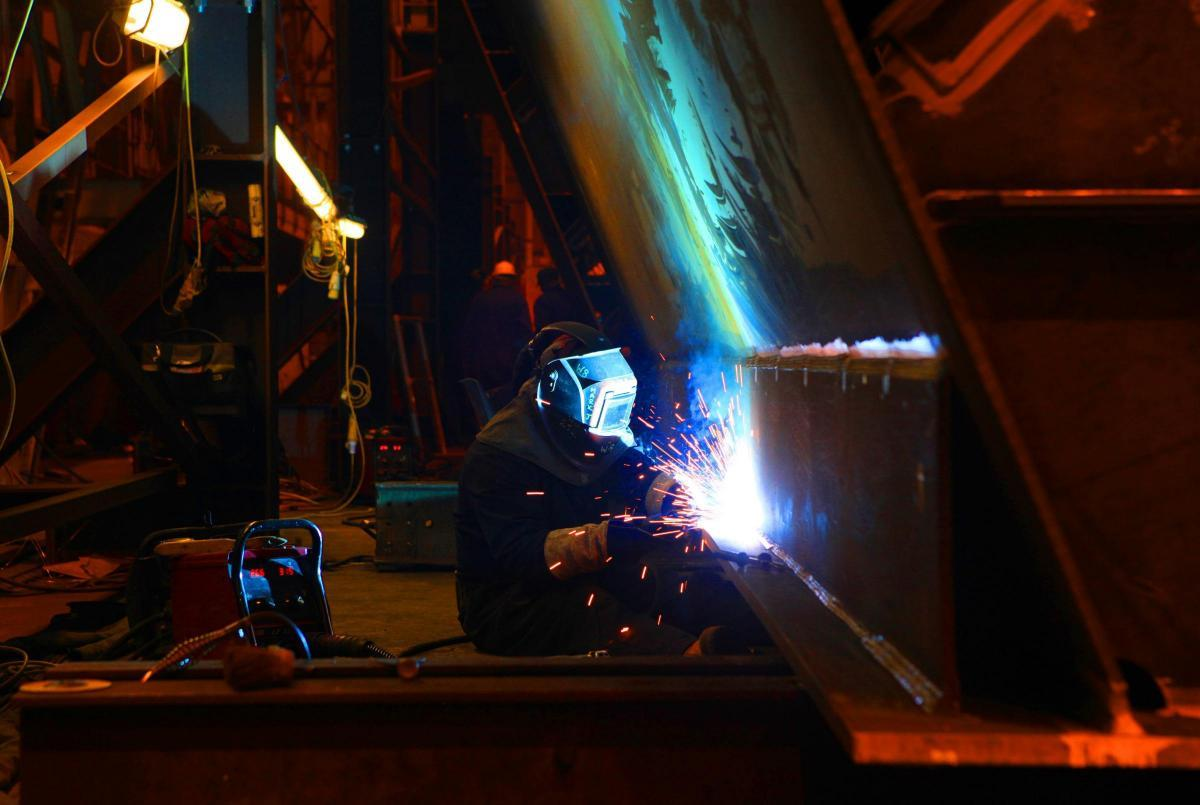 CONSTRUCTION WORK: A welder makes sparks fly on a huge structure at Darlington's Cleveland Bridge