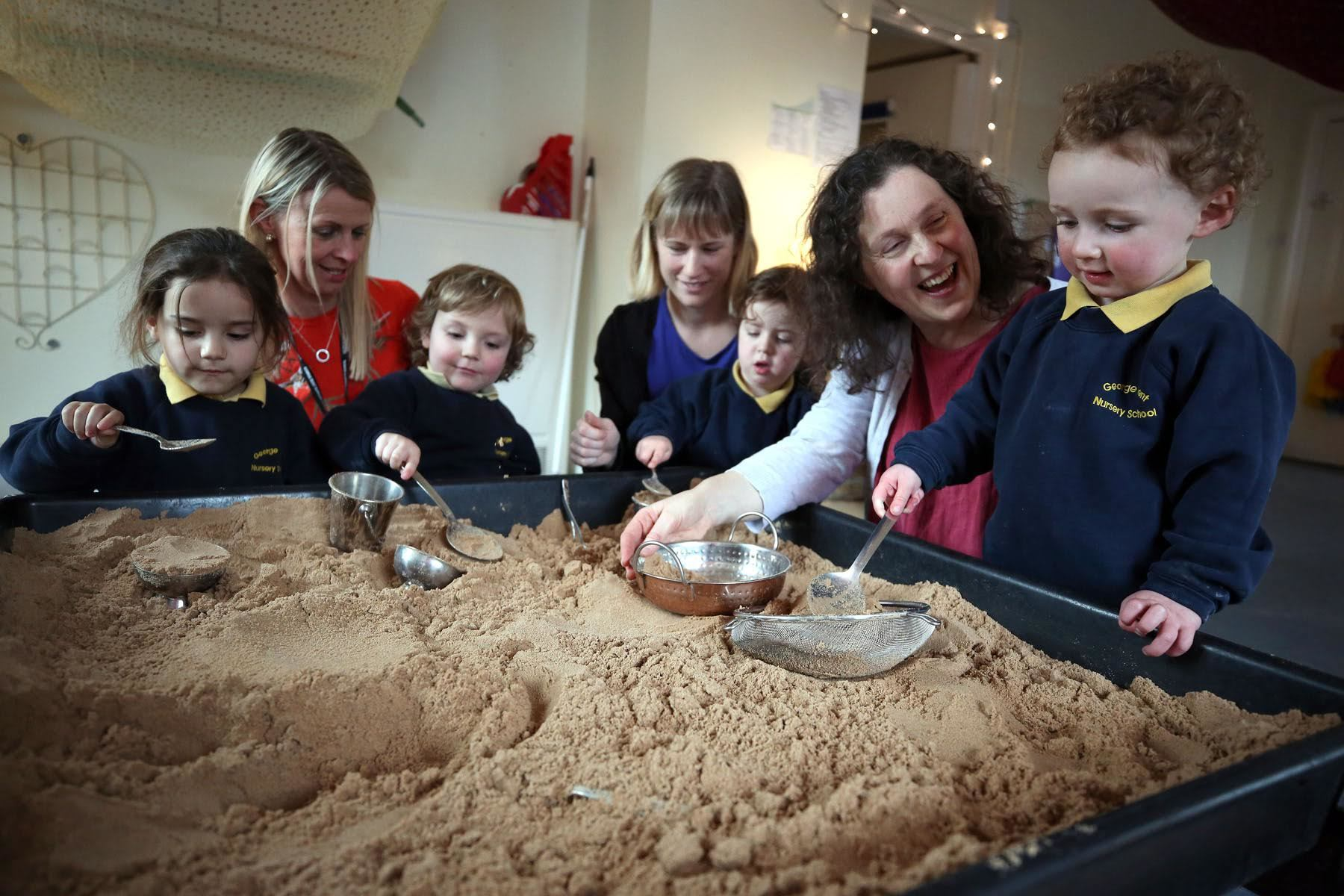 The George Dent Nursery on Elms Road in Darlington has received its seventh outstanding Ofsted report in a row. Playing in the sand are Freya Haymer (three), executive head teacher Helen Dummett, Nathaniel Birtles (three), Orchard Room manager Katie Taylo