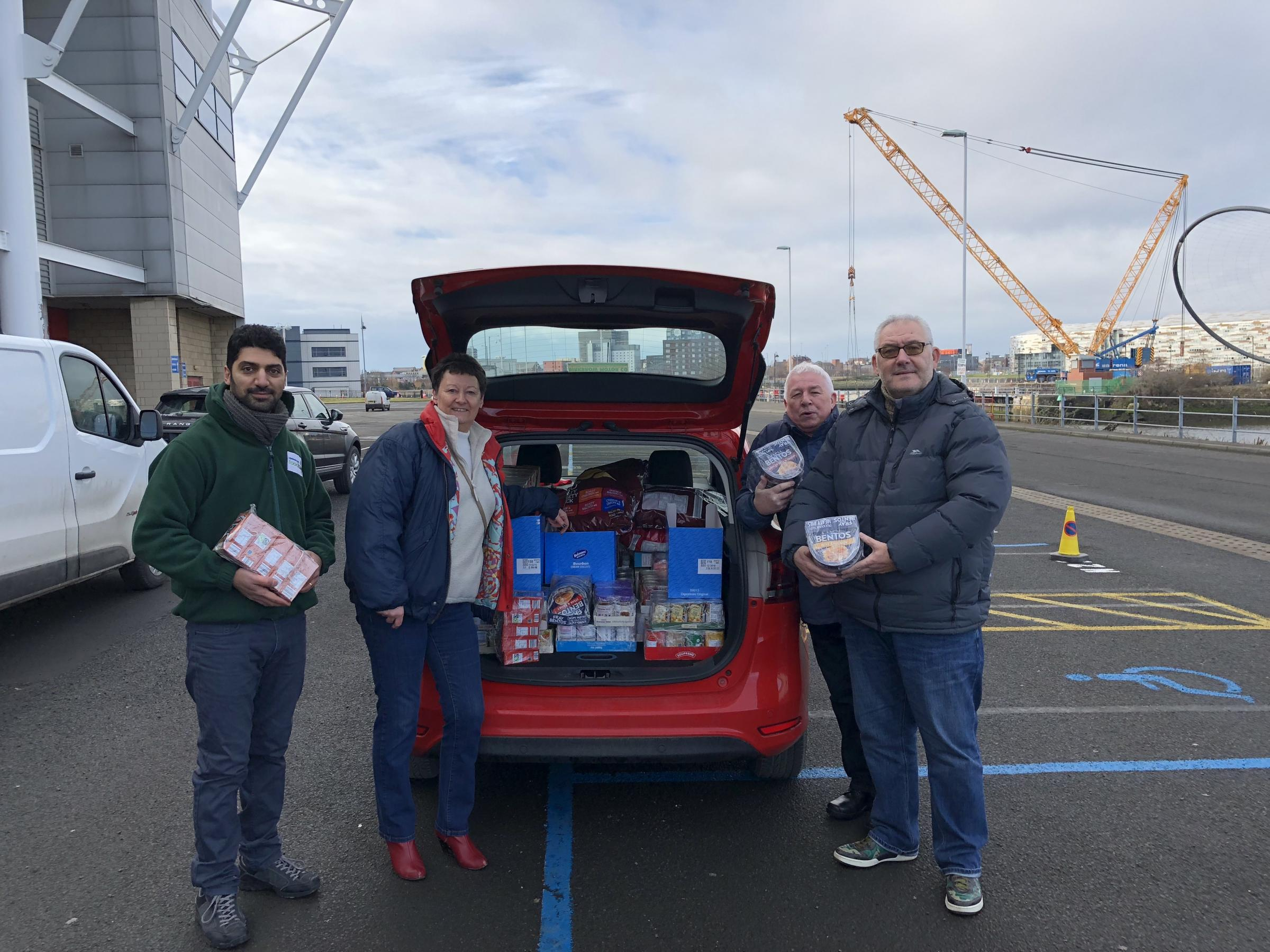 DONATIONS: Soroush Sadeghzadeh, project manager at Middlesbrough Foodbank, Caroline Walker, chairwoman of Middlesbrough Supporters Forum, Peter Hodgson, secretary of MSF, Steve rock, chairman of Middlesbrough Official Supporters club handing over its cont