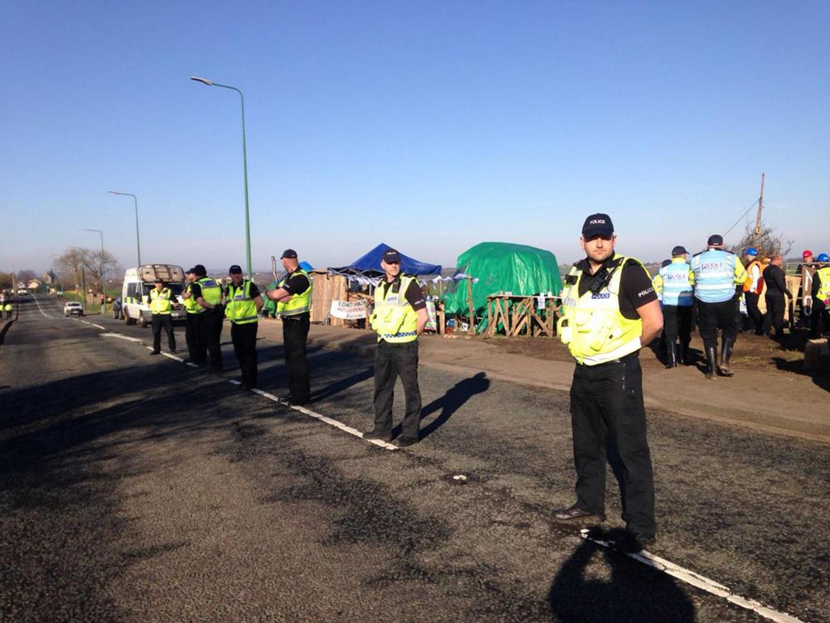 Officers line the road as bailiffs move onto the site to remove protestors in April 2018