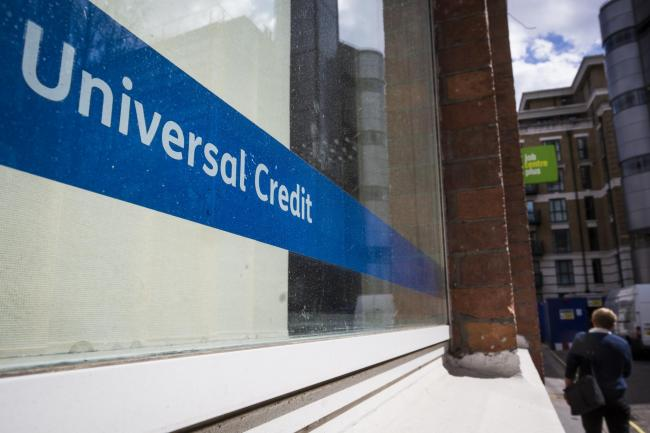A Universal Credit sign in the window of the Job Centre
