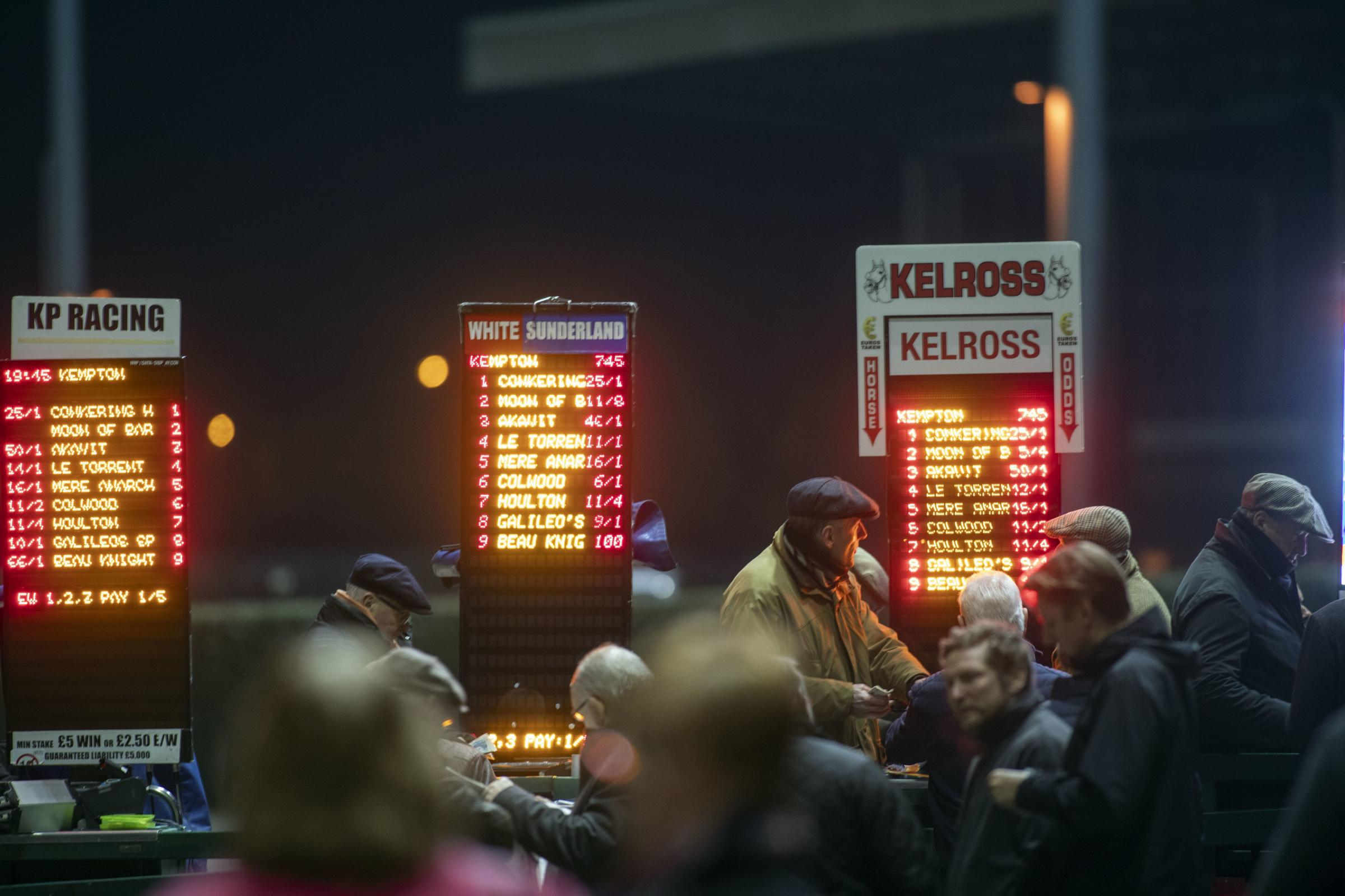 Spectators bet at Kempton Park Racecourse, Esher. PRESS ASSOCIATION Photo. Picture date: Wednesday February 13, 2019. See PA story RACING Kempton. Photo credit should read: Steve Parsons/PA Wire.