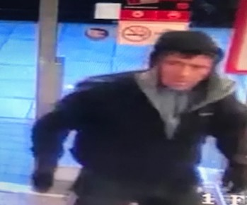 Do you recognise this man? Police hunt shop robbery suspect