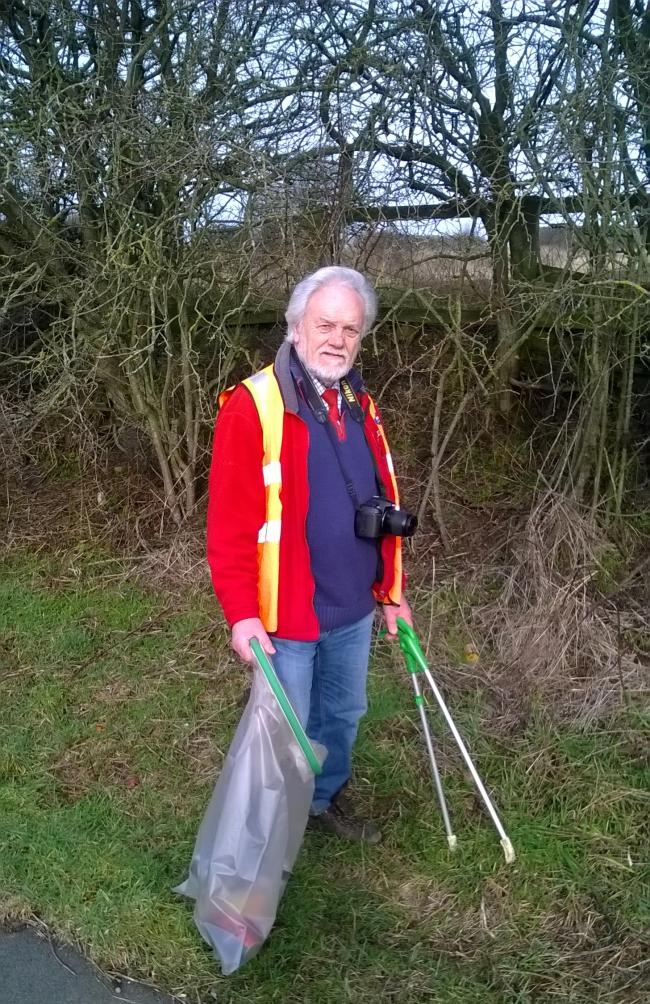 Dedicated environmentalist Cllr Gerald Lee picking up litter