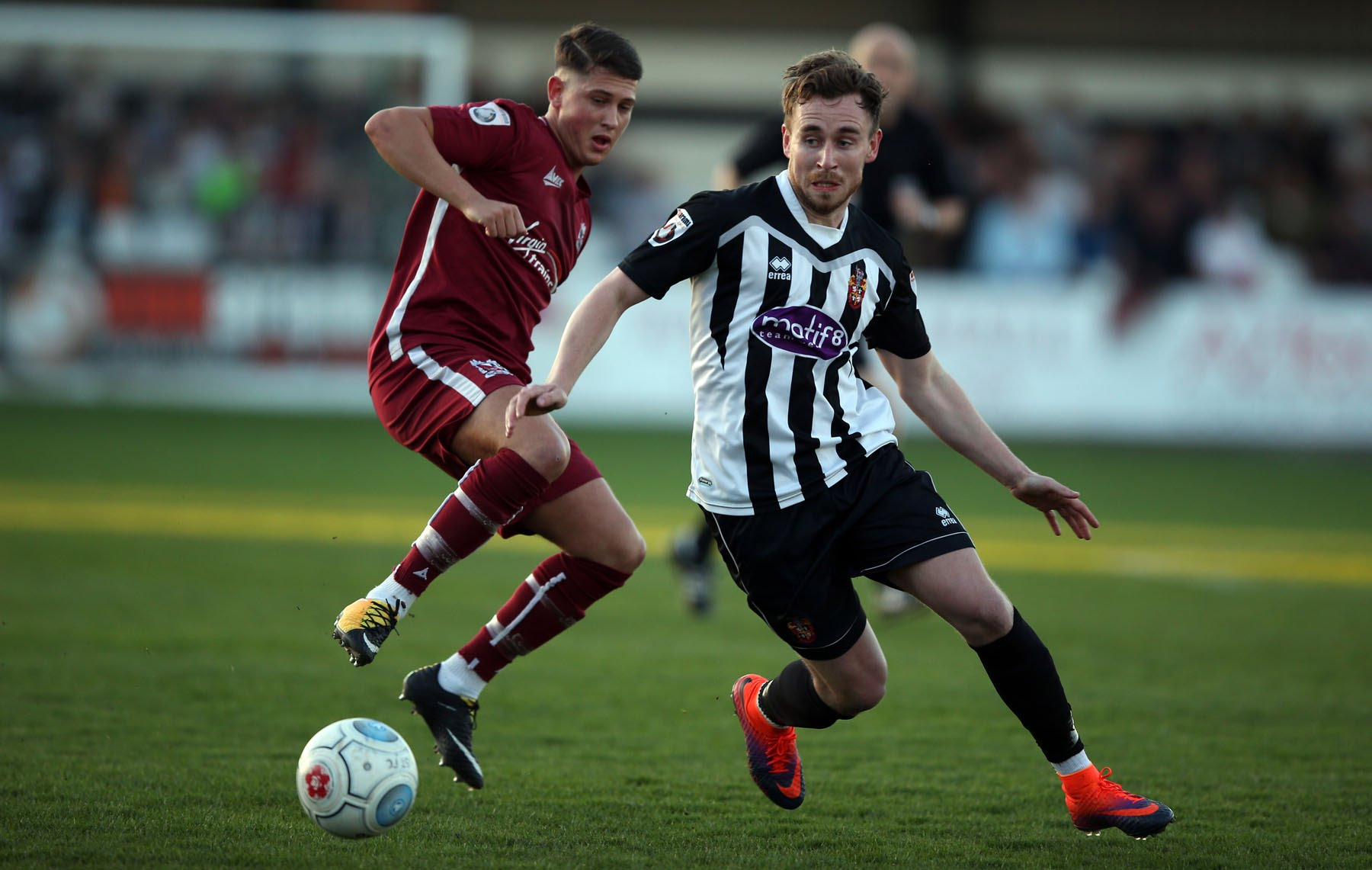 Mark Anderson of Spennymoor Town and Josef Wheatley of Darlington. Picture: CHRIS BOOTH.