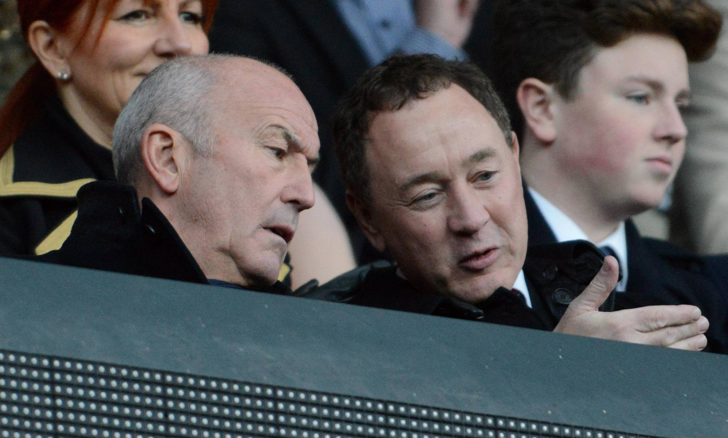 Tony Pulis takes his seat in the stands alongside chairman Steve Gibson.