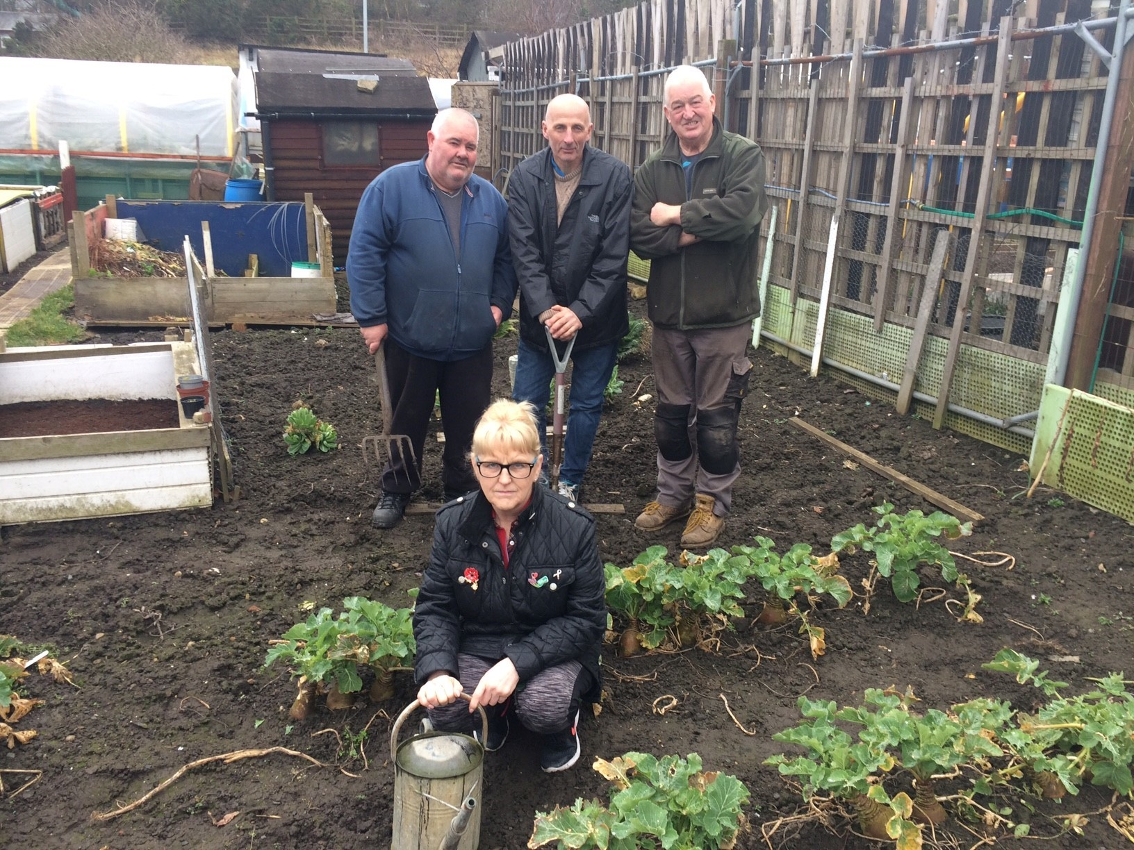 ACTION NEEDED: Allotment holders are concerned at the number of break-ins at their plots. Back row, from left, Richy Stacey, Ken Watson and Alan Kirkbride, with Angela Kirkbride in front.
