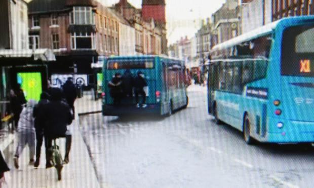 Children clinging to back of bus in Darlington town centre