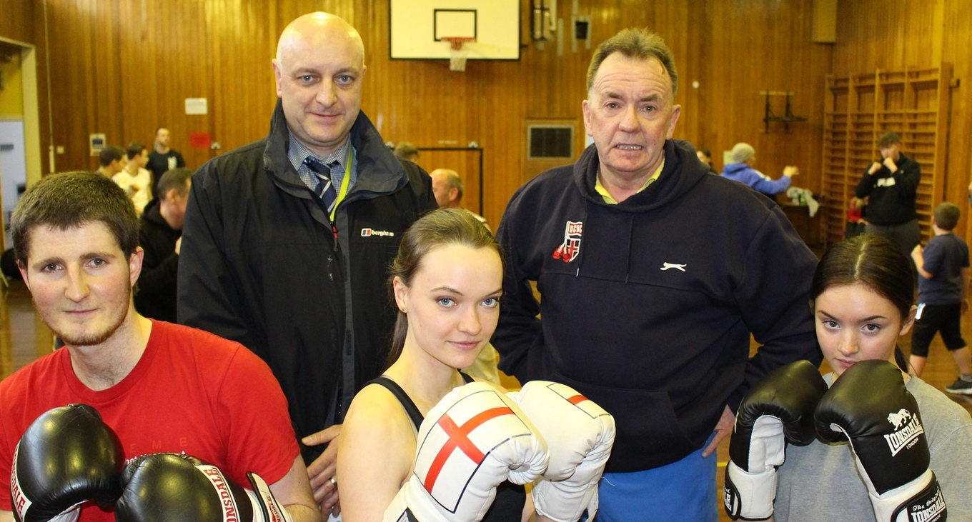 BOXING CLUB: Damian Pearson from County Durham Housing Group, left, and Paul Lysaght from Durham Community Boxing Club, with some of the club members