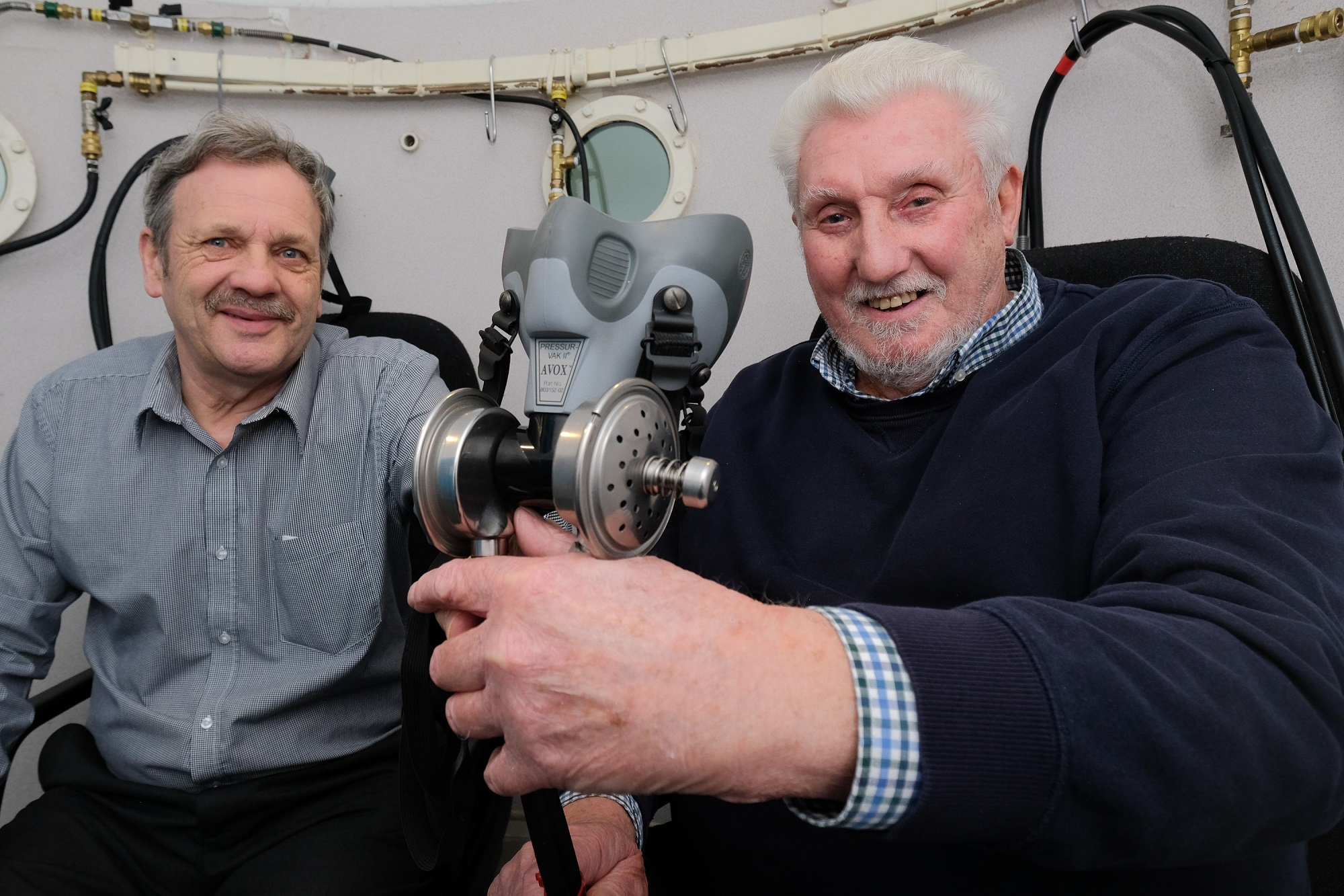 PLAN HATCHED: Centre manager Alan Riddiough, left, with Bill Scot Snr inside the oxygen therapy chamber