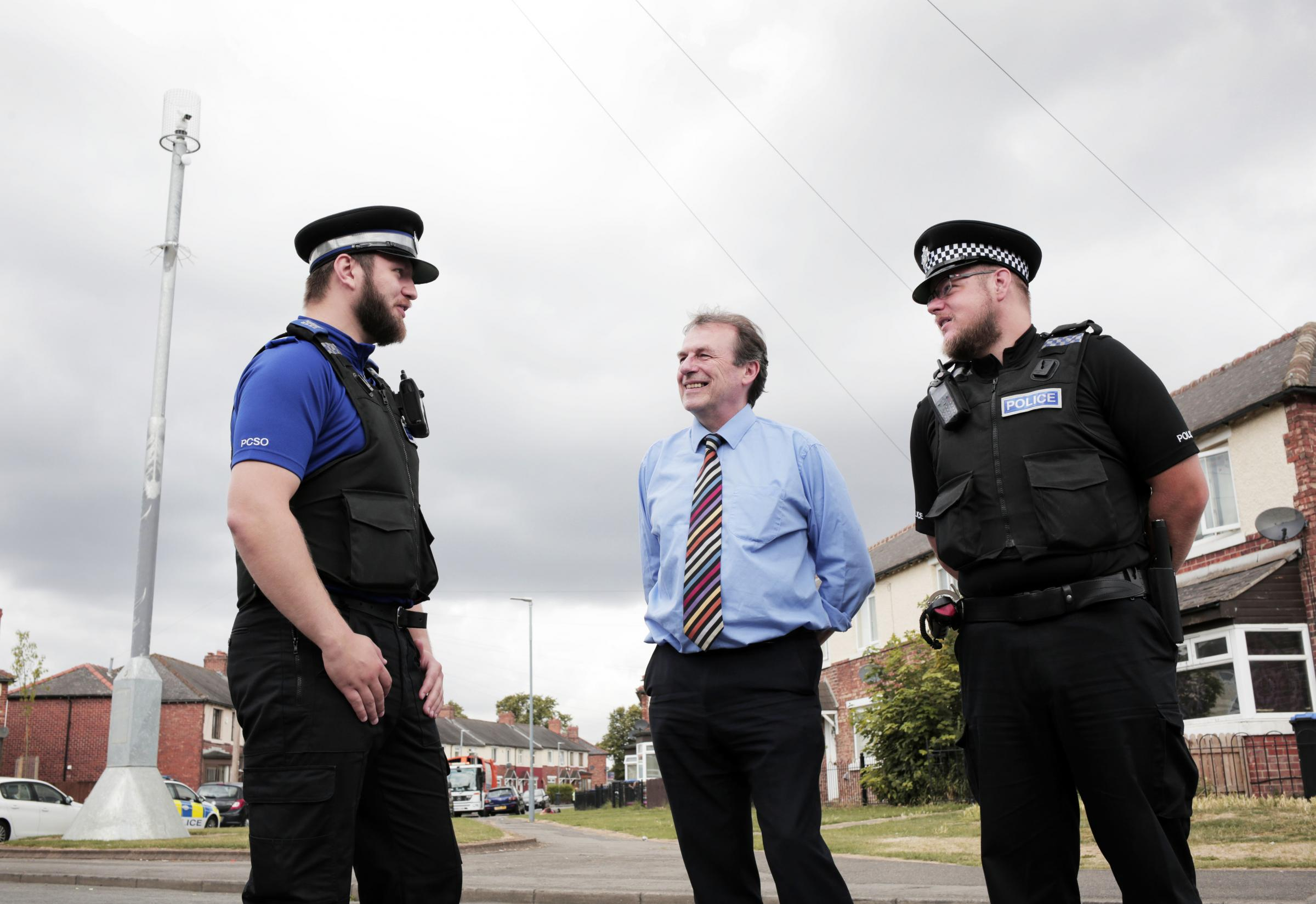 CONFIDENT: Barry Coppinger with PC Chris Swales and PCSO Steven Cook in Grove Hill Picture: STUART BOULTON