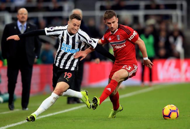 Newcastle United's Javier Manquillo (left) and Fulham's Joe Bryan battle for the ball during the Premier League match at St James' Park, Newcastle. PRESS ASSOCIATION Photo. Picture date: Saturday December 22, 2018. See PA story SOCCER Newcastl