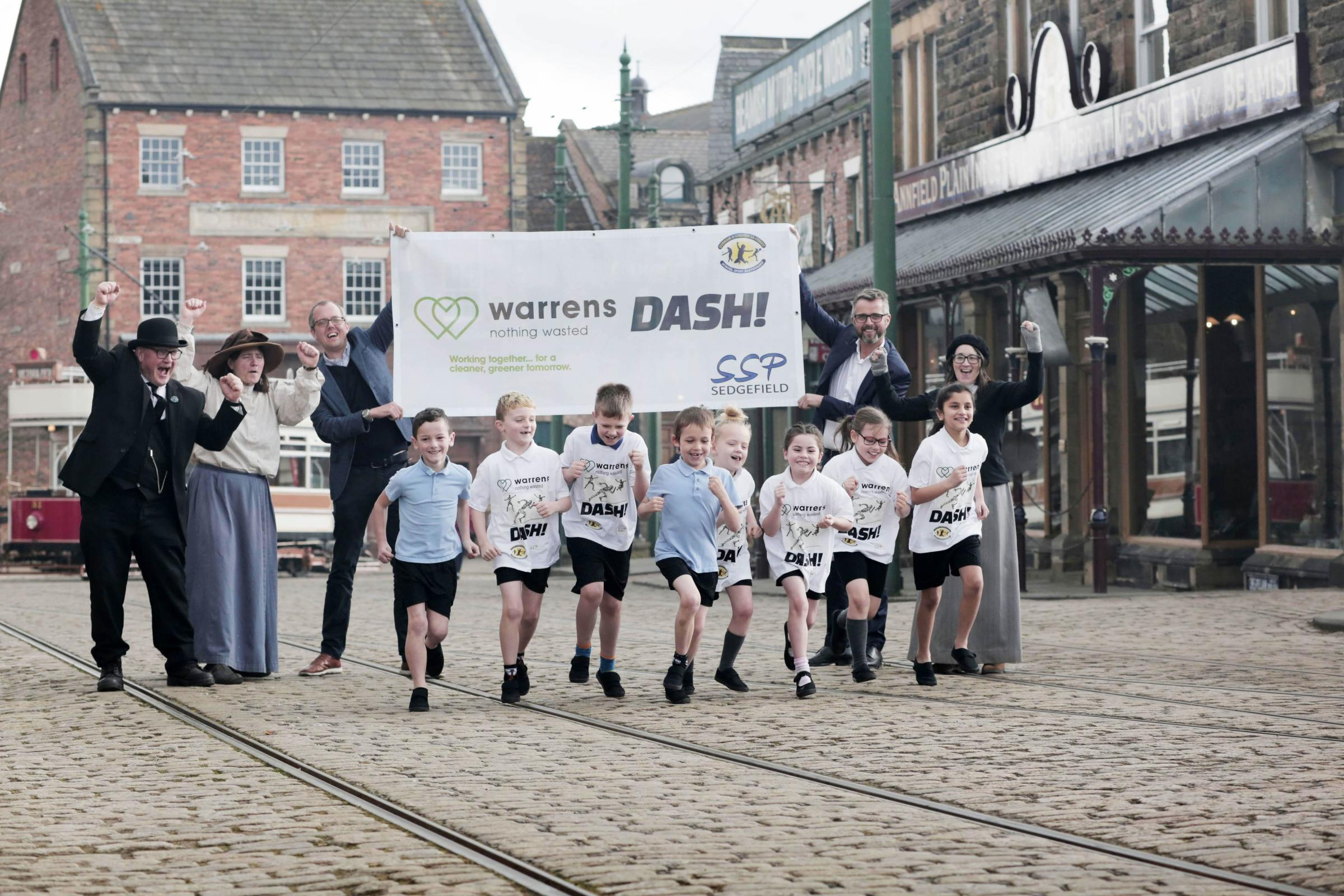 NEW VENUE: Children from Beamish School get ready for the 2019 Durham Dash at the Beamish Museum with sponsors Antony and Adam Warren of Warren's Grow and museum staff Colin Shipley, Catherine Rice and Hannah Cadwallader. Picture: STUART BOULTON