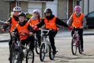 Children riding their bicycles. A growing number of parents want cycle training to be part of the national curriculum in schools. Picture: PA