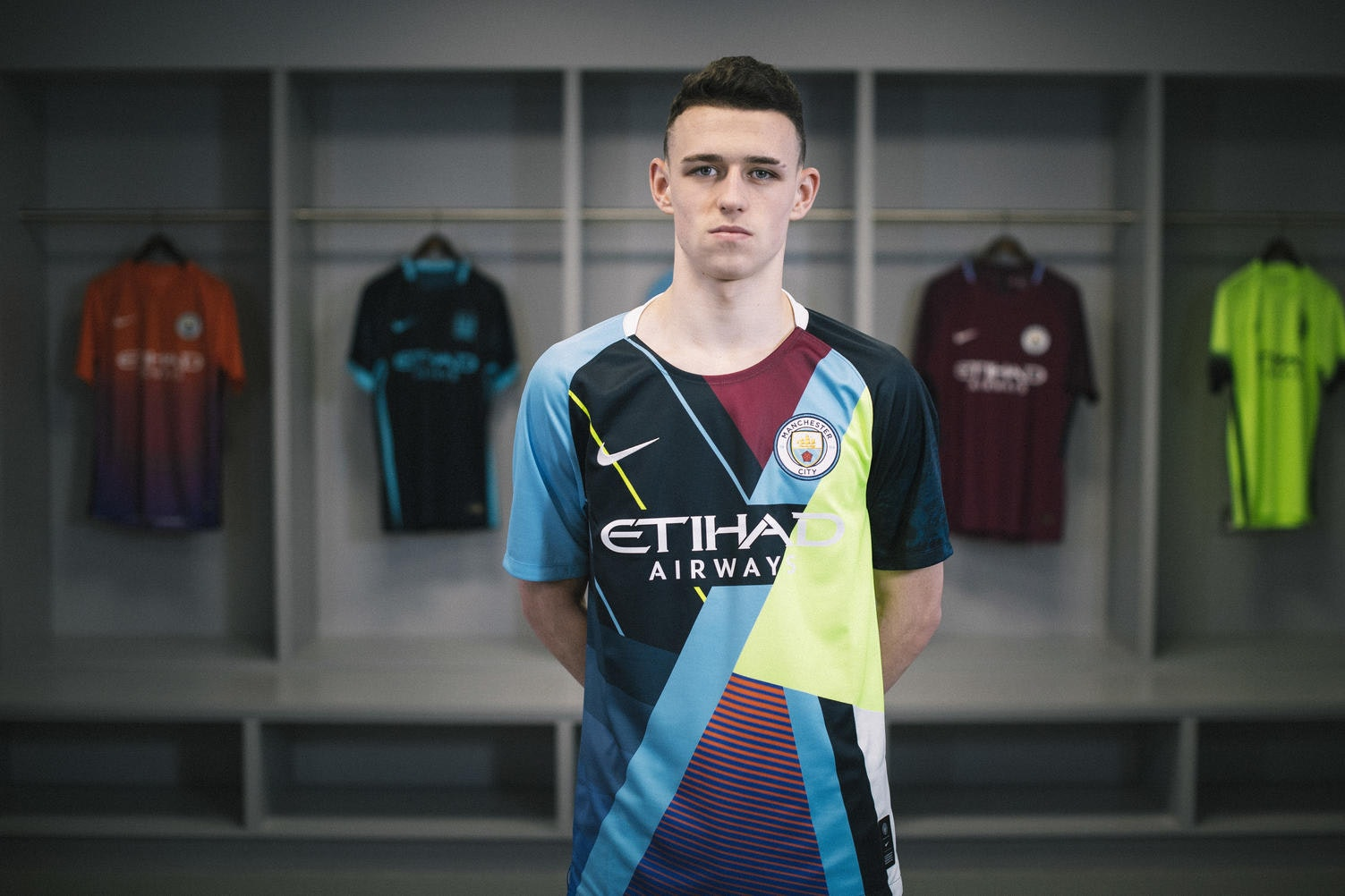 Manchester City midfielder Phil Foden models the club's new celebration shirt