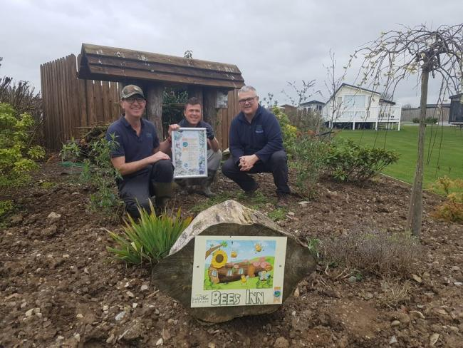 GOLD: York House Holiday Park's gardener Paul Sorbie, grounds assistant Dawid Potoczny and manager John Reay with the David Bellamy Gold Conservation Award